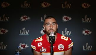 Kansas City Chiefs tight end Travis Kelce (87) speaks during a news conference on Thursday, Jan. 30, 2020, in Aventura, Fla., for the NFL Super Bowl 54 football game. (AP Photo/Brynn Anderson)