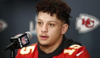 Kansas City Chiefs quarterback Patrick Mahomes (15) speaks during a news conference on Thursday, Jan. 30, 2020, in Aventura, Fla., for the NFL Super Bowl 54 football game. (AP Photo/Brynn Anderson)