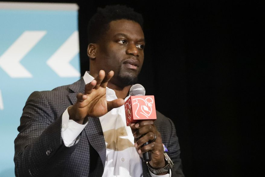 In this file photo, New England Patriots' Benjamin Watson speaks during the NFL Players Association annual state of the union news conference on Thursday, Jan. 30, 2020, in Miami Beach, Fla. (AP Photo/Chris Carlson)  **FILE**