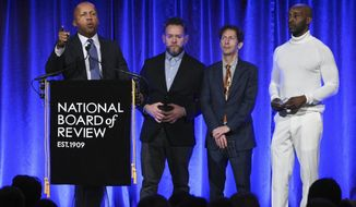 """Lawyer Bryan Stevenson, left, and producer Asher Goldstein, actors Tim Blake Nelson and Rob Morgan accept the award NBR freedom of expression award for """"Just Mercy,"""" at the National Board of Review Awards gala at Cipriani 42nd Street on Wednesday, Jan. 8, 2020, in New York. (Photo by Evan Agostini/Invision/AP)"""