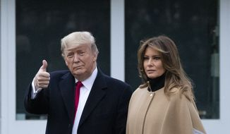 President Donald Trump, accompanied by first lady Melania Trump, gives thumbs up as he walks on the South Lawn as they depart the White House, Friday, Jan. 31, 2020, in Washington. Trump is en route to his Mar-a-Lago resort in Palm Beach, Fla. (AP Photo/Alex Brandon)