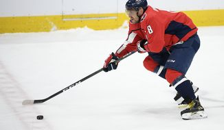 Washington Capitals left wing Alex Ovechkin (8), of Russia, skates with the puck during the third period of an NHL hockey game against the Nashville Predators, Wednesday, Jan. 29, 2020, in Washington. The Predators won 5-4. (AP Photo/Nick Wass) ** FILE **