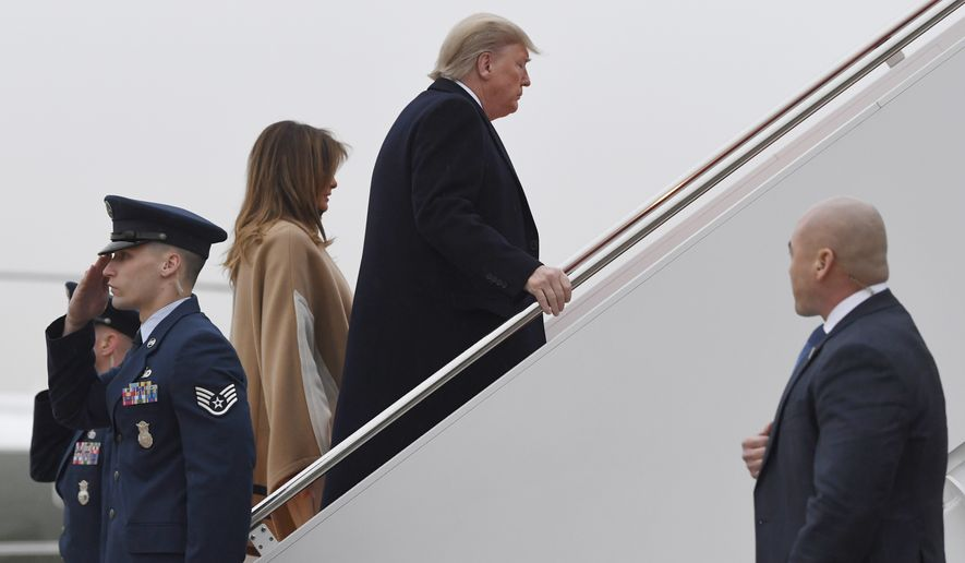 President Donald Trump and first lady Melania Trump walk up the steps of Air Force One at Andrews Air Force Base in Md., Friday, Jan. 31, 2020. The Trump's are heading to Florida to spend the weekend at their Mar-a-Lago estate. (AP Photo/Susan Walsh)