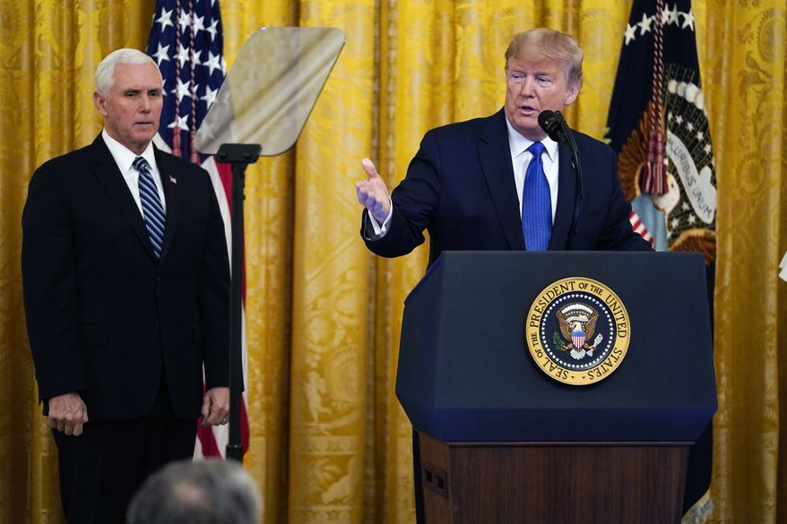 President Donald Trump speaks during an event on human trafficking in the East Room of the White House, Friday, Jan. 31, 2020, in Washington, as Vice President Mike Pence looks on.  (AP Photo/ Evan Vucci)