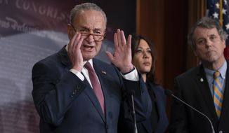 Senate Minority Leader Chuck Schumer, D-N.Y., joined at right by Sen. Kamala Harris, D-Calif., and Sen. Sherrod Brown, D-Ohio, as he speaks to reporters to criticize the process in the Republican-controlled Senate as the impeachment trial of President Donald Trump on charges of abuse of power and obstruction of Congress, resumes in Washington, Friday, Jan. 31, 2020. (AP Photo/J. Scott Applewhite)