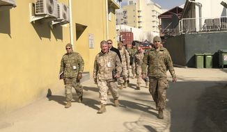 Marine Gen. Frank McKenzie, center, top U.S. commander for the Middle East, makes an unannounced visit, Friday, Jan. 31, 2020 in Kabul, Afghanistan. (AP Photos/Lolita Baldor)