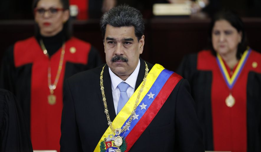 Venezuelan President Nicolas Maduro stands inside the Supreme Court in Caracas, Venezuela, Friday, Jan. 31, 2020. Maduro is at the court to give his annual presidential address. (AP Photo/Ariana Cubillos)