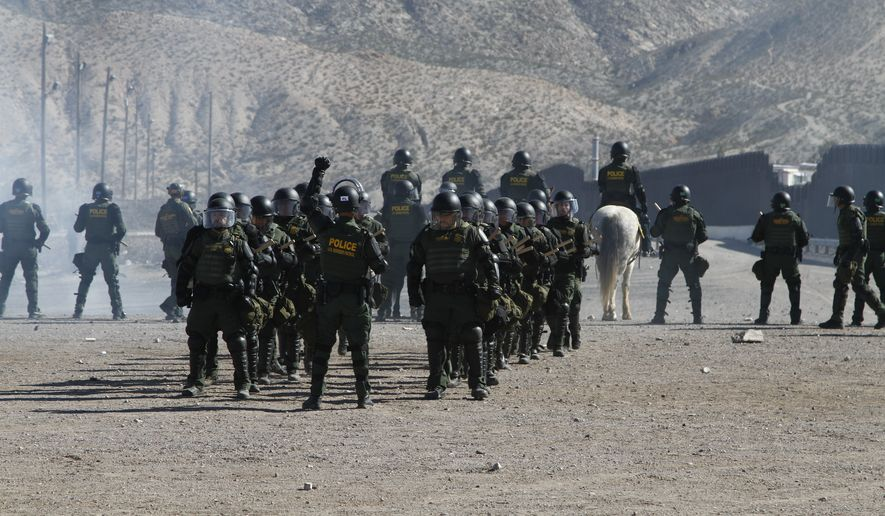 Border Patrol agents including four mounted on horseback train to respond to hostile crowds throwing rocks at a border fence on the US-Mexico border on Friday, Jan. 31, 2020, in nearby town of Sunland Park, New Mexico. The exercise was part of an annual use-of-force training for agents in the El Paso sector, which covers southern New Mexico and west Texas. (AP Photo/Cedar Attanasio)