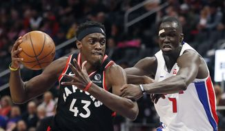 Detroit Pistons forward Thon Maker (7) reaches in and fouls Toronto Raptors forward Pascal Siakam (43) during the first half of an NBA basketball game Friday, Jan. 31, 2020, in Detroit. (AP Photo/Carlos Osorio)