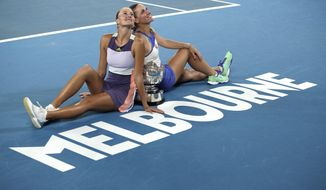 Hungary's Timea Babos, right, and France's Kristina Mladenovic, left, pose for a photo with the Australian Open women's doubles trophy after defeating Taiwan's Hsieh Su-Wei and Barbora Strycova of the Czech Republic at the Australian Open tennis championship in Melbourne, Australia, Friday, Jan. 31, 2020. (AP Photo/Andy Wong)