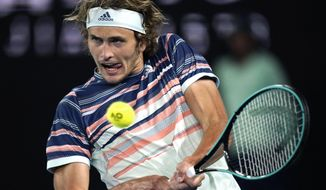 Germany's Alexander Zverev makes a backhand return to Austria's Dominic Thiem during their semifinal match at the Australian Open tennis championship in Melbourne, Australia, Friday, Jan. 31, 2020. (AP Photo/Lee Jin-man)