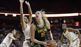 Baylor forward Lauren Cox (15) looks to shoot past Texas guard Celeste Taylor during the first half of an NCAA college basketball game Friday, Jan. 31, 2020, in Austin, Texas. (AP Photo/Eric Gay)