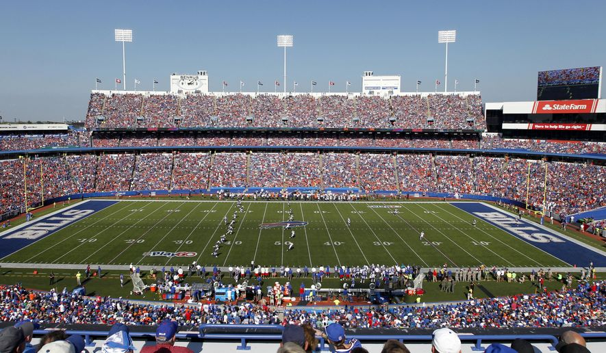 FILE - In this Sept. 24, 2017, file photo, fans watch during the second half of an NFL football game between the Buffalo Bills and the Denver Broncos at  New Era Field in Orchard Park, N.Y. The Bills have informed county officials they will not use an early and one-time opt-out clause to terminate their lease at New Era Field. The team's decision, sent in a letter to Erie County Executive Mark Poloncarz on Friday, Jan. 31, 2020, was considered a formality, but in no way rules out the possibility of the Bills one day playing at new facility in downtown Buffalo.  (AP Photo/Jeffrey T. Barnes, File)