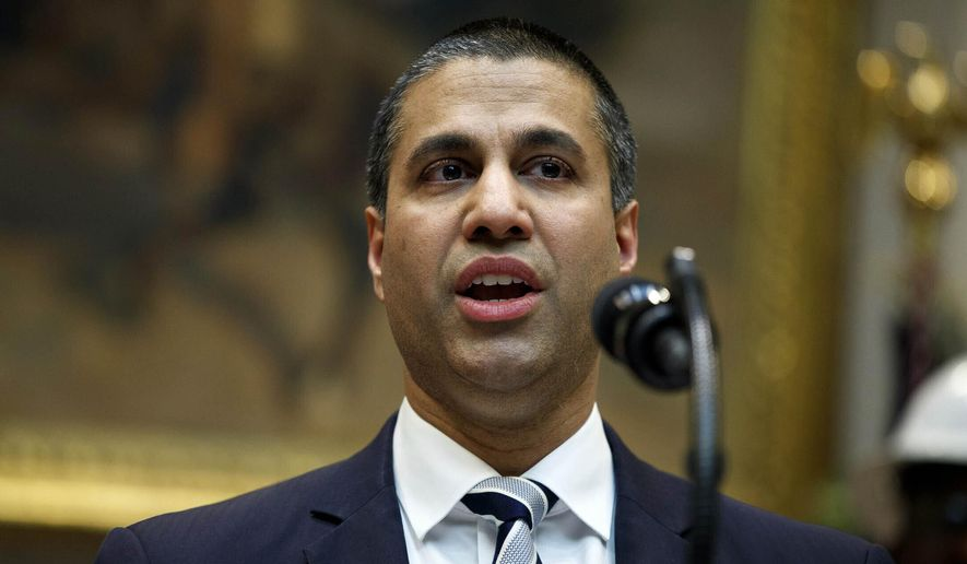 In this April 12, 2019, file photo, Federal Communications Commission Chairman Ajit Pai speaks during an event in Washington. (AP Photo/Evan Vucci, File)
