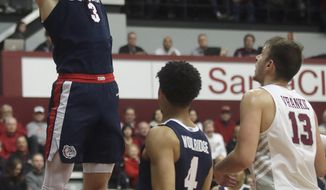 Gonzaga forward Filip Petrusev (3) dunks in front of guard Ryan Woolridge (4) and Santa Clara forward Josip Vrankic (13) during the first half of an NCAA college basketball game in Santa Clara, Calif., Thursday, Jan. 30, 2020. (AP Photo/Jeff Chiu)