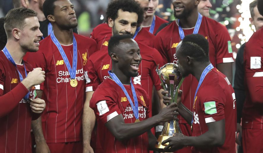 Liverpool's Sadio Mane kisses the trophy after winning the Club World Cup final soccer match between Liverpool and Flamengo at Khalifa International Stadium in Doha, Qatar, Saturday, Dec. 21, 2019. (AP Photo/Hassan Ammar)