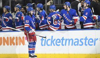 New York Rangers center Mika Zibanejad (93) is congratulated after scoring a goal during the third period of the team's NHL hockey game against the Detroit Red Wings, Friday, Jan. 31, 2020, in New York. This was Zibanejad's 200th point scored while with the Rangers. (AP Photo/Sarah Stier)