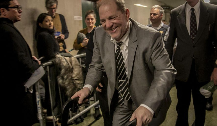 Harvey Weinstein, center, leaves Manhattan's Criminal Court after a key accuser in his rape trial testified Friday Jan. 31, 2020, in New York. (AP Photo/Bebeto Matthews)