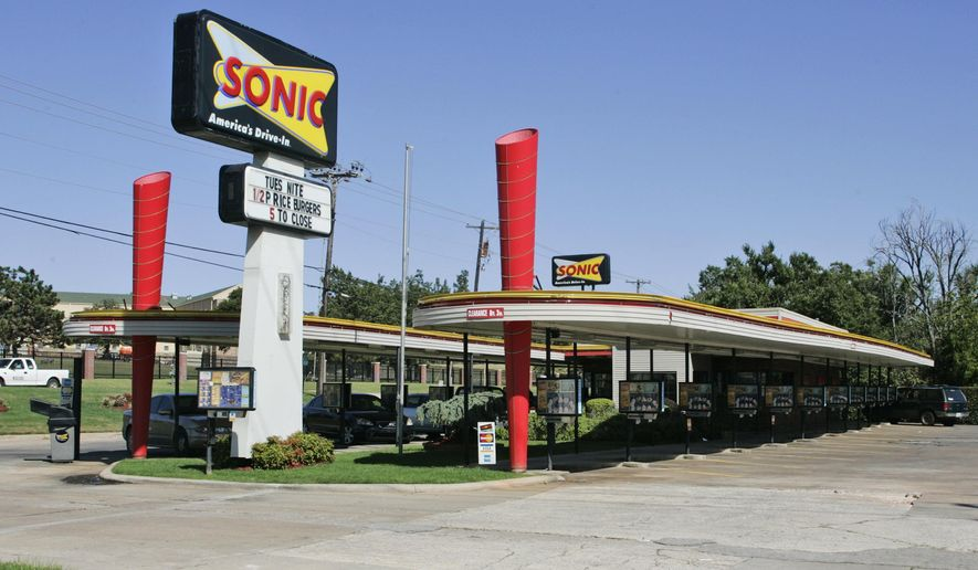 In this Oct. 1, 2008, file photo, is a Sonic Restaurant in Oklahoma City. Oklahoma City-based Sonic Corp. will lay off employees at its headquarters and transfer others to Atlanta where it's parent company, Inspire Brands is headquartered. Sonic spokeswoman Christi Woodward said Friday, Jan. 31, 2020, the changes are part of Sonic's integration into Inspire, which purchased the drive-in restaurant chain in 2018 for $2.3 billion. (AP Photo/Sue Ogrocki, File) **FILE**