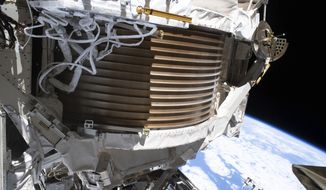 This Dec. 2, 2019 photo made available by NASA shows the Alpha Magnetic Spectrometer (AMS) attached to the International Space Station. After a series of spacewalking repairs, NASA says the cosmic particle detector has resumed full scientific operation on Friday, Jan. 31, 2020. (NASA via AP)