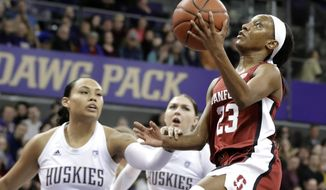 Stanford guard Kiana Williams, right, shoots past Washington forward Mai-Loni Henson, left, and forward Haley Van Dyke during the first half of an NCAA college basketball game, Friday, Jan. 31, 2020, in Seattle. (AP Photo/Ted S. Warren)