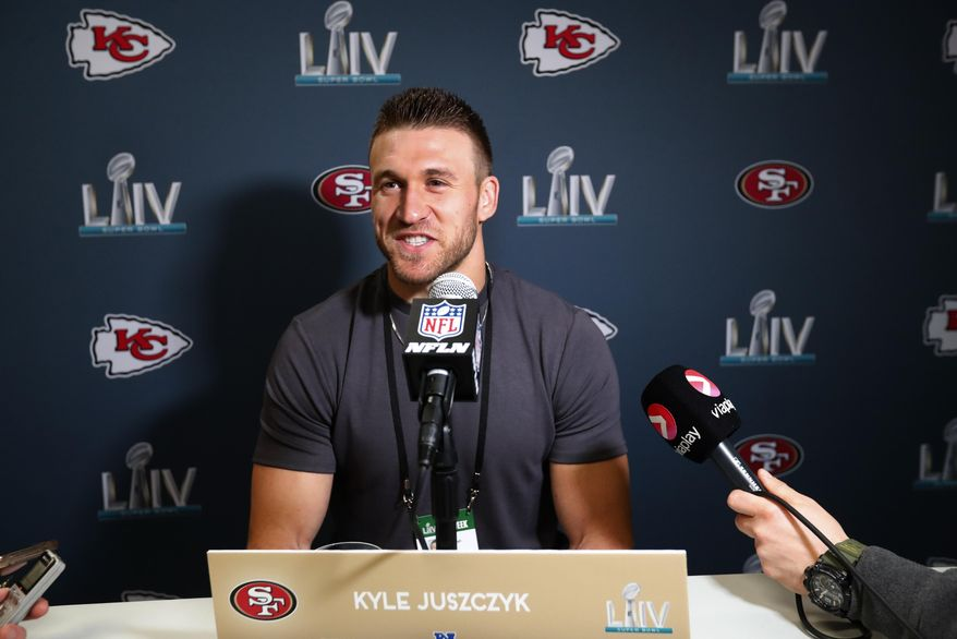 San Francisco 49ers fullback Kyle Juszczyk smiles as he speaks during a media availability for the NFL Super Bowl 54 football game, on Tuesday, Jan. 28, 2020, in Miami. (AP Photo/Wilfredo Lee)