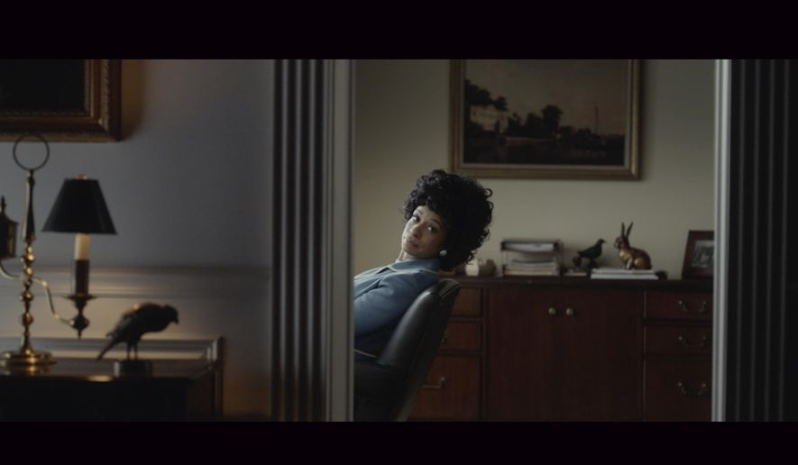 This undated image provided by Amazon shows a scene from the company's 2020 Super Bowl NFL football spot. Amazon will once again tout its Alexa voice assistant ad in a 90-second ad starring talk show host Ellen DeGeneres and her wife actress Portia de Rossi as they imagine what people did before they could ask Alexa to perform tasks. (Amazon via AP)