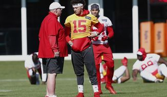 Kansas City Chiefs quarterback Patrick Mahomes (15) talks with head coach Andy Reid during practice on Wednesday, Jan. 29, 2020, in Davie, Fla., for the NFL Super Bowl 54 football game. (AP Photo/Brynn Anderson)
