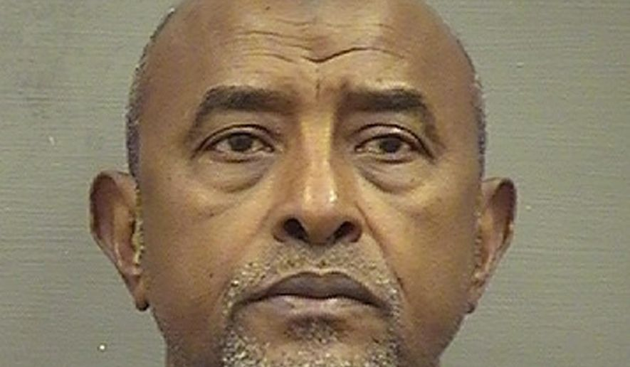 FILE - This Saturday, May 4, 2019, file booking photo provided by the Alexandria, Va. Sheriff's Office shows Abdirizak Jaji Raghe Wehelie, of Burke, Va. Wehelie of Burke, Virginia, pleaded guilty in November to making false statements. He will be sentenced Friday in federal court in Alexandria. (Alexandria Sheriff's Office via AP)