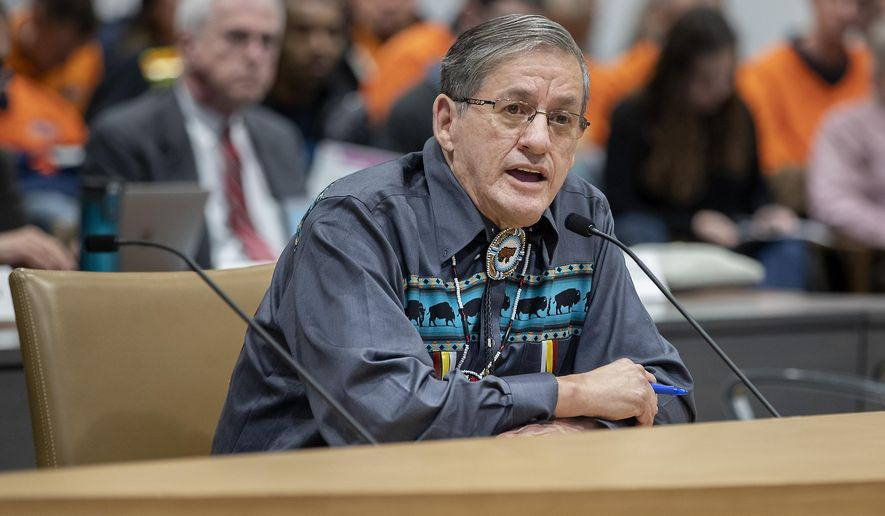Chief Kenneth Chalmers addressed a group of four PUC commissioners as they took in comments and sentiments directly from the public regarding the controversial Line 3 oil pipeline during a hearing at the Senate Office Building, Friday, Jan. 31, 2020 in St. Paul, Minn.  (Elizabeth Flores/Star Tribune via AP)