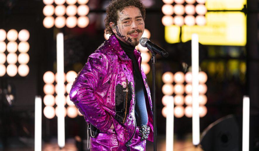 Post Malone performs at the Times Square New Year's Eve celebration, Tuesday, Dec. 31, 2019, in New York. (Photo by Ben Hider/Invision/AP)