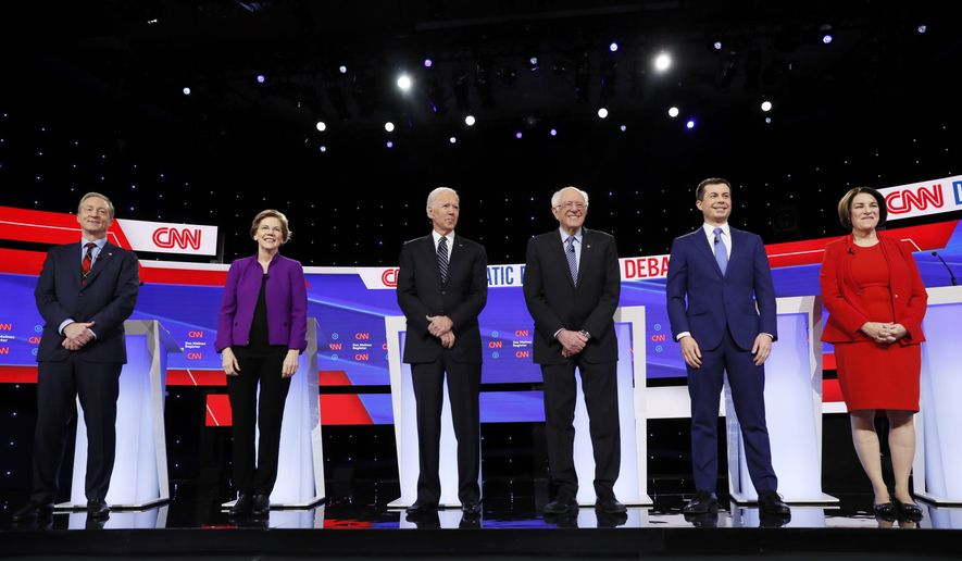 In this Tuesday, Jan. 14, 2020, file photo, from left, Democratic presidential candidates businessman Tom Steyer, Sen. Elizabeth Warren, D-Mass., former Vice President Joe Biden, Sen. Bernie Sanders, I-Vt., former South Bend Mayor Pete Buttigieg, and Sen. Amy Klobuchar, D-Minn., stand on stage before a Democratic presidential primary debate hosted by CNN and the Des Moines Register in Des Moines, Iowa. On Saturday, Feb. 1, 2020, the Des Moines Register, CNN and its polling partner have decided not release the final installment of its presidential preference poll, fearing its results may have been compromised. (AP Photo/Charlie Neibergall)