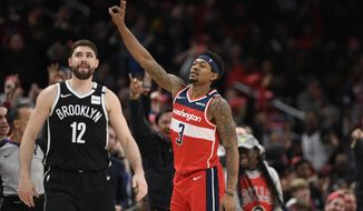 Washington Wizards guard Bradley Beal (3) gestures after he hit a three-point basket during the second half of an NBA basketball game against the Brooklyn Nets, Saturday, Feb. 1, 2020, in Washington. Nets forward Joe Harris (12) looks on. (AP Photo/Nick Wass) ** FILE **