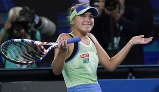Sofia Kenin of the U.S. celebrates after defeating Spain's Garbine Muguruza in the women's singles final at the Australian Open tennis championship in Melbourne, Australia, Saturday, Feb. 1, 2020. (AP Photo/Lee Jin-man)