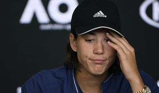 Spain's Garbine Muguruza answers questions at press conference following her loss to Sofia Kenin of the U.S. in the women's final at the Australian Open tennis championship in Melbourne, Australia, Saturday, Feb. 1, 2020. (AP Photo/Andy Brownbill)