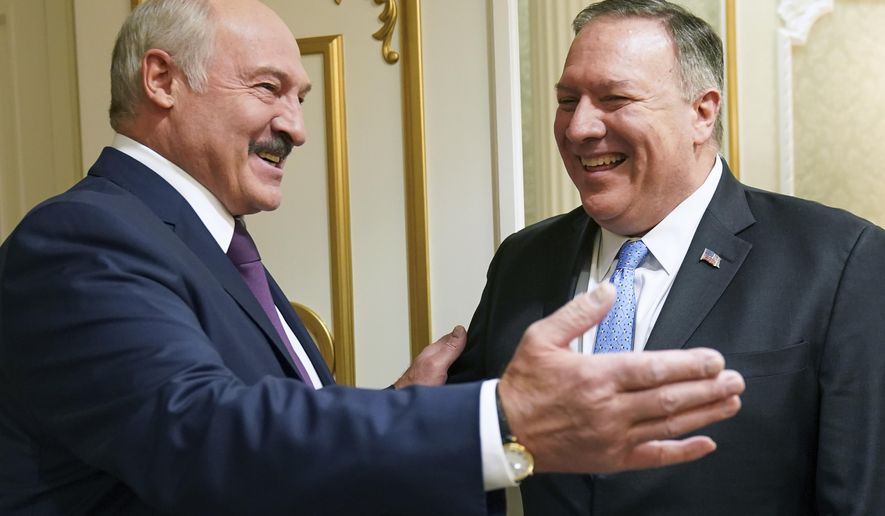 Belarusian President Alexander Lukashenko greets U.S. Secretary of State Mike Pompeo during a meeting in Minsk, Belarus, Saturday, Feb. 1, 2020. (Kevin Lamarque/Pool Photo via AP)