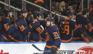 Edmonton Oilers' Leon Draisaitl (29) celebrates a goal against the St. Louis Blues during the third period of an NHL hockey game Friday, Jan. 31, 2020, in Edmonton, Alberta. (Jason Franson/The Canadian Press via AP)