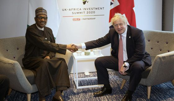 Britain's Prime Minister Boris Johnson, right, meets the President of Nigeria Muhammadu Buhari during the UK-Africa Investment Summit in London, Monday, Jan. 20, 2020. Boris Johnson is hosting 54 African heads of state or government in London. The move comes as the U.K. prepares for post-Brexit dealings with the world. (Eddie Mulholland/Pool Photo via AP)
