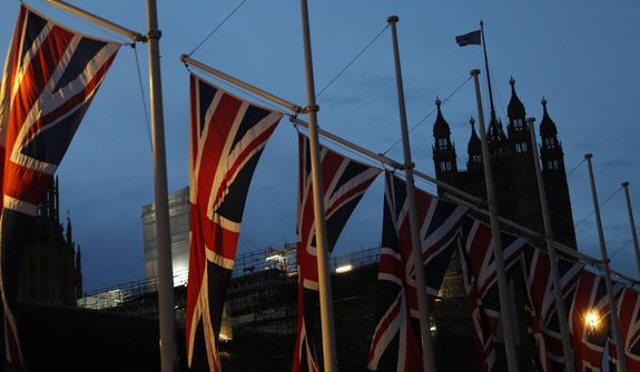 F]The first light of dawn breaks looking towards the Palace of Westminster with British Union flags flying in London, Saturday, Feb. 1, 2020. Britain officially left the European Union on Friday after a debilitating political period that has bitterly divided the nation since the 2016 Brexit referendum. (AP Photo/Alastair Grant)