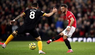 Manchester United's Bruno Fernandes, controls the ball, during the English Premier League soccer match between Manchester United and Wolverhampton Wanderers, at Old Trafford, in Manchester, England, Saturday, Feb. 1, 2020. (Martin Rickett/PA via AP)