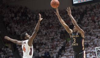 Florida State guard Trent Forrest (3) shoots over Virginia Tech defender Nahiem Alleyne (4) during the first half of an NCAA college basketball game in Blacksburg, Va., Saturday, Feb. 1, 2020. (AP Photo/Lee Luther Jr.)
