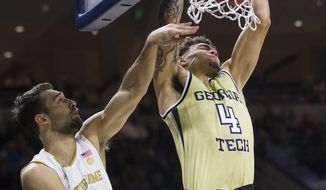 Georgia Tech's Jordan Usher (4) dunks over Notre Dame's Nikola Djogo (13) during the first half of an NCAA college basketball game Saturday, Feb. 1, 2020, in South Bend, Ind. (AP Photo/Robert Franklin)