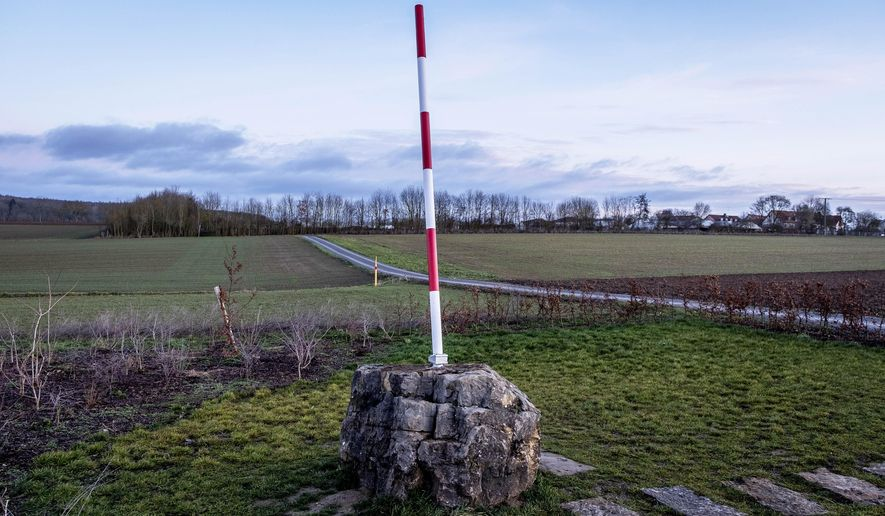 A pole marks the new geographical center of the European Union after the Brexit in Veitshoechheim-Gadheim, southern Germany, Thursday, Jan. 30, 2020. (AP Photo/Michael Probst)