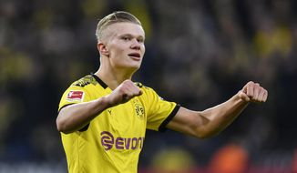 Dortmund's scorer Erling Haaland celebrates after he scored his second goal during the German Bundesliga soccer match between Borussia Dortmund and Union Berlin in Dortmund, Germany, Saturday, Feb. 1, 2020. (AP Photo/Martin Meissner)