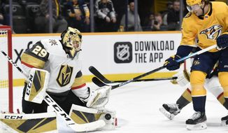Vegas Golden Knights goaltender Marc-Andre Fleury (29) blocks a shot by Nashville Predators right wing Craig Smith (15) during the second period of an NHL hockey game Saturday, Feb. 1, 2020, in Nashville, Tenn. (AP Photo/Mark Zaleski)