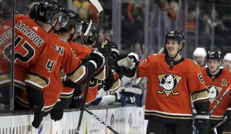 Anaheim Ducks left wing Rickard Rakell, second from right, of Sweden, celebrates with teammates on the bench after scoring against the Tampa Bay Lightning during the first period of an NHL hockey game in Anaheim, Calif., Friday, Jan. 31, 2020. (AP Photo/Alex Gallardo)