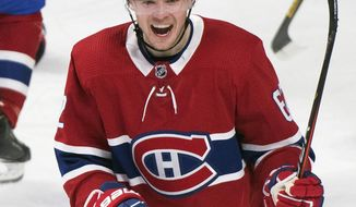 Montreal Canadiens' Artturi Lehkonen smiles after scoring against the Florida Panthers during the second period of an NHL hockey game, Saturday, Feb. 1, 2020 in Montreal. (Graham Hughes/The Canadian Press via AP)