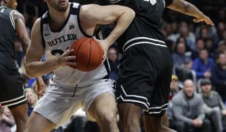 Butler forward Bryce Golden (33) goes around Providence forward Kalif Young (13) in the first half of an NCAA college basketball game in Indianapolis, Saturday, Feb. 1, 2020. (AP Photo/Michael Conroy)