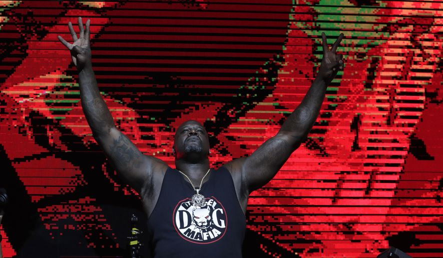 Former NBA basketball player Shaquille O' Neal DJ's at Shaq's Fun House, Saturday, Feb. 1, 2020, in Miami. This carnival themed music festival is one of numerous events taking place in advance of Miami hosting Super Bowl LIV on Feb. 2. (AP Photo/Lynne Sladky)