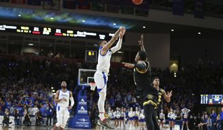 Tulsa guard Elijah Joiner (3) hits the game winning three pointer against Wichita State in the second half of Tulsa's 54-51 win over Wichita State in an NCAA college basketball game in Tulsa, Okla., Saturday, Feb. 1, 2020. (AP Photo/Joey Johnson)